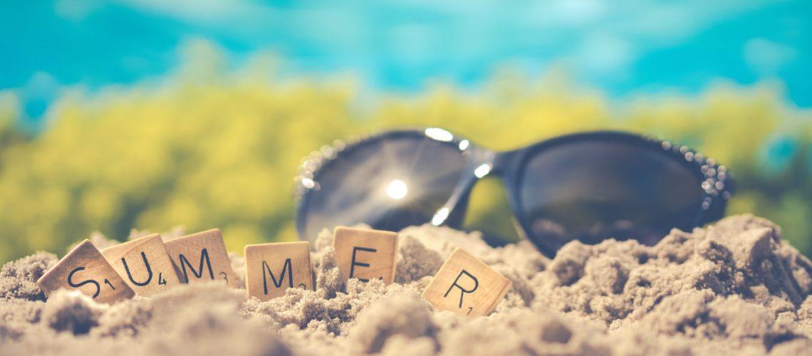 macro-photography-of-black-sunglasses-on-sand-1209610